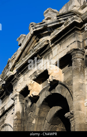 France, Gard, Nimes, the arenas, pediment ornamented with bulls over the main of the four axial gates - Stock Photo