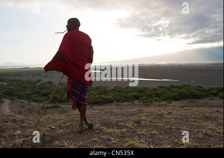 Tanzania, Arusha Region, Rift Valley, surroundings of lake Natron, a Maasai at sunrise - Stock Photo