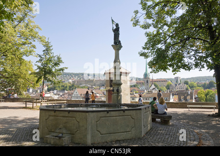 Horizontal wide angle view from Lindenhof hill with Predigerkirche, Preachers Church spire prominent on the skyline. - Stock Photo
