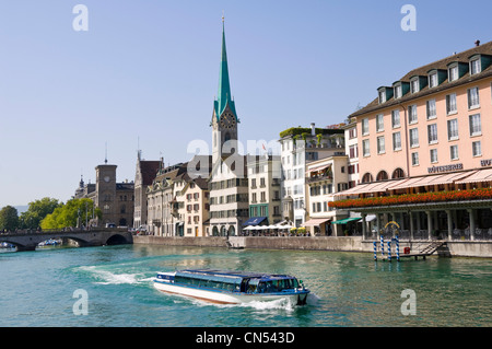 Horizontal wide angle of Fraumünster kirche or abbey with it's prominent spire in central Zurich on a sunny day. - Stock Photo