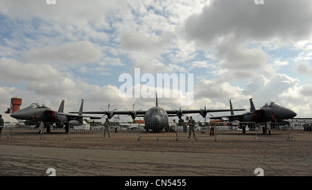 MARRAKECH, Morocco -- A C-130J Super Hercules sits between two F-15E Strike Eagles on the flightline at the Marrakech - Stock Photo