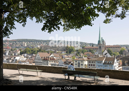 Horizontal wide angle of the view from Lindenhof hill with Predigerkirche, Preachers Church spire prominent on the - Stock Photo