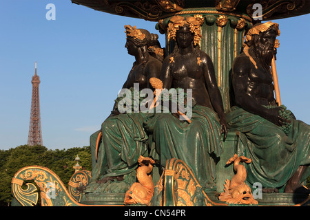 France, Paris, Place de la Concorde, Fontaine des Mers (Fountain of the Seas) and the Eiffel Tower in the background - Stock Photo