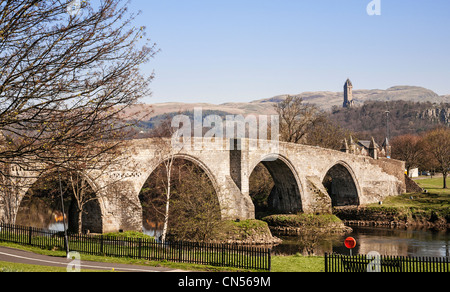 Historic Stirling Bridge with the national Wallace Monument in the distance, Scotland. - Stock Photo