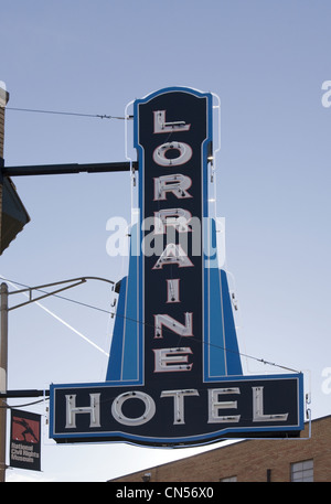 A vintage black and blue neon sign advertising the historic Lorraine Hotel in Memphis, Tennessee