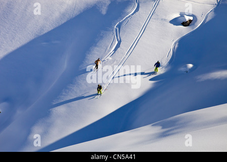 France, Savoie, Massif de La Vanoise, La Tarentaise Valley, Valmorel, teenager off-piste skiing in powder snow - Stock Photo
