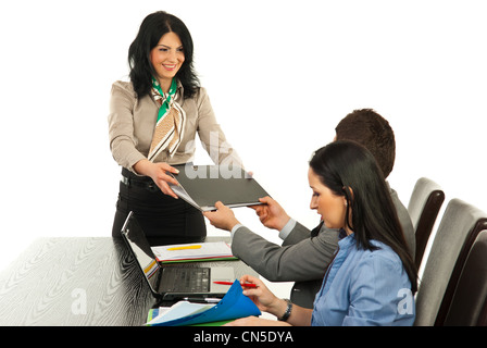 Happy manager woman giving folder to executive man at meeting against white background - Stock Photo