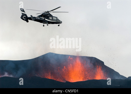 Iceland, Sudurland Region, helicopter flying over the Fimmvorduhals Volcano, volcanic eruption between the Glacier - Stock Photo