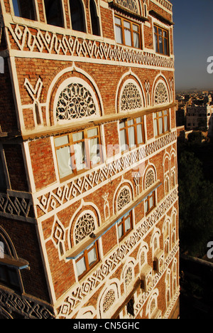 Yemen, Sanaa, old town listed as World Heritage by UNESCO, an old building with white decorative carvings and arched - Stock Photo