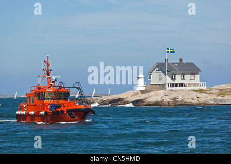 Pilot boat on the way to Marstrand in Sweden - Stock Photo