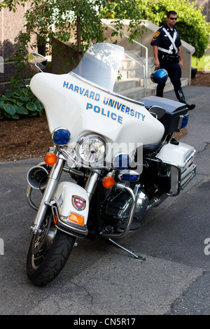 Motorcycle of the Harvard University Police (HUPD) and its rider at Harvard Campus, Cambridge, MA. - Stock Photo