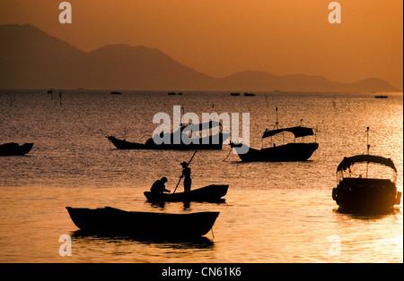 sampans at sunset in South China Sea off Hong Kong New Territories Coast China - Stock Photo