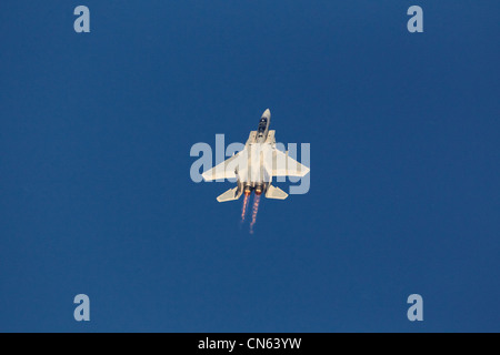 USAF McDonnall Douglas F15D Eagle in steep climb with afterburners on - Stock Photo