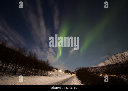 Aurora borealis or northern lights moving across night sky within the Arctic Circle Tromso Troms norway 2012 - Stock Photo
