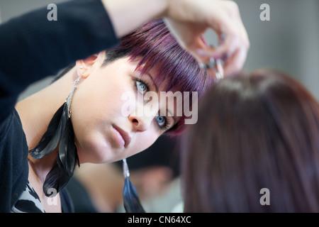 Woman getting a haircut at a beauty salon - Stock Photo