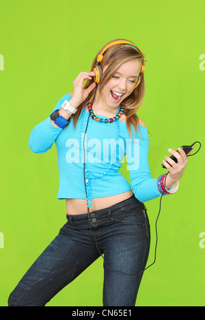 teen with headphones listening to music - Stock Photo