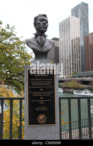 Bronze Bust of Jean-Baptiste Pointe DuSable, Founder of Chicago, Illinois. Located beside DuSable Bridge over Chicago - Stock Photo