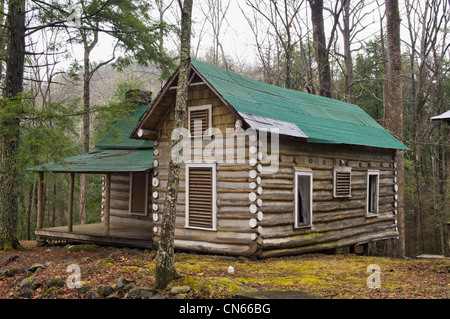 Log Cabin at Millionaires Row in Elkmont Area of the Great Smoky Mountains National Park in Tennessee - Stock Photo