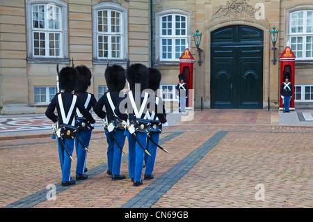 Changing of the Guard Ceremony in front of Amalienborg Palace. Copenhagen, Denmark - Stock Photo