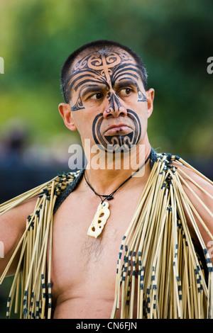 Traditional tattoos on face of Maori warrior - Stock Photo