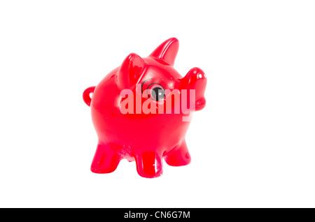 Isolated red pig money-box on white background. Saving money for black day. Nest-egg. - Stock Photo