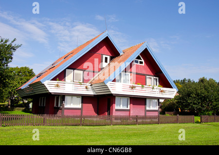 Rural architecture colorful garden house and beautiful landscaped environment around it. - Stock Photo