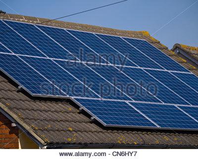 Solar Panels on Bungalow Roof - Stock Photo