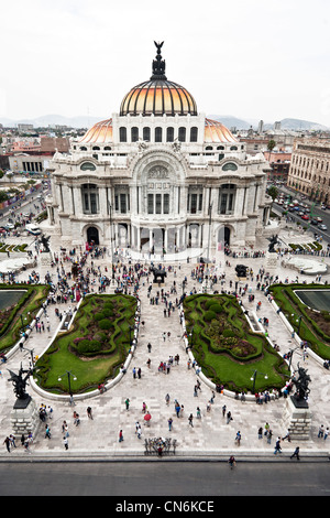 looking down on gardens & entrance facade of Palacio de Bellas Artes & long ticket waiting line for Botero exhibit - Stock Photo