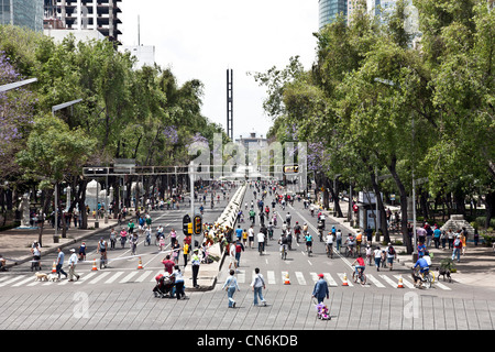 Paseo de la Reforma looking toward Chapultapec is crowded with bicyclists pedestrians dog walkers on a beautiful - Stock Photo