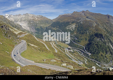 Rhone Valley and Gletsch with the Rhone Glacier from the Grimsel Pass in the Canton of Valais in Switzerland - Stock Photo