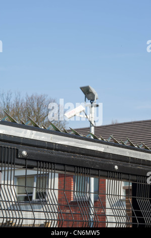 CCTV cameras installed on a refurbished housing estate in Sheffield - Stock Photo