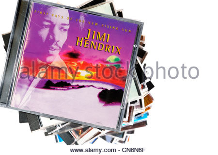 Jimi Hendrix 1997 First Rays of the new rising Sun album on a stack of CD cases on a white background, England - Stock Photo