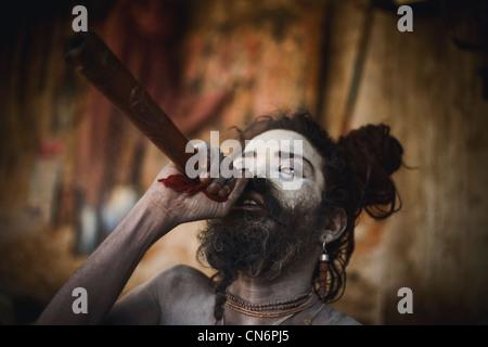 Balak Das Baba smoking chilum (clay pipe ) during Shivaratri festival at Pashupatinath , Kathmandu - Stock Photo