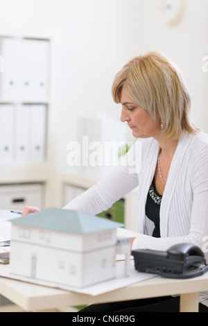 Middle age architect woman working at office - Stock Photo