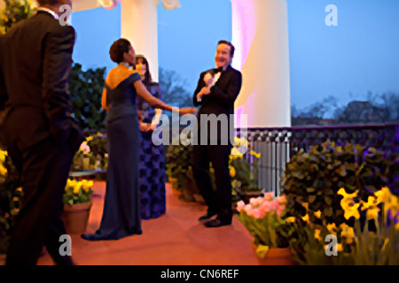 President Barack Obama and First Lady Michelle Obama visit with Prime Minister David Cameron of the United Kingdom - Stock Photo