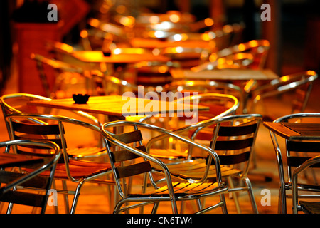 Café  empty chairs and tables at night, outside location - Stock Photo