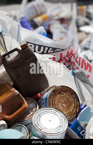 Paint cans thrown away Wales, UK - Stock Photo