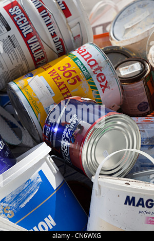 Paint cans thrown away, Wales, UK - Stock Photo