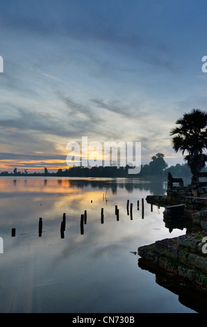 Sunrise from Srah Srang Temple over Moat, Ankor Wat, Cambodia - Stock Photo