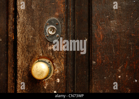 Close up of old brass doorknob and iron handles stock for Door eye hole