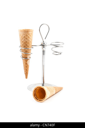 Empty wafer cone on white background with a support - Stock Photo