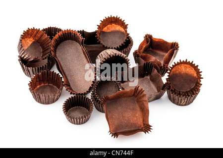 Chocolate Brown Mixed bakery cups on white background - Stock Photo