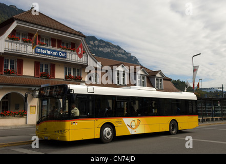Bus outside the Ost station in Interlaken in the Canton of Bern in Switzerland - Stock Photo