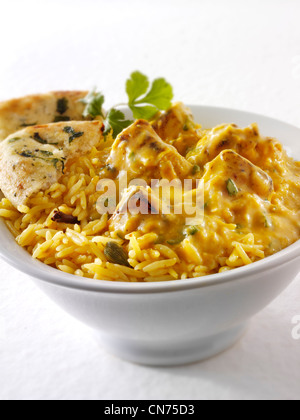 Chicken Korma Curry,  pilau rice - Stock Photo