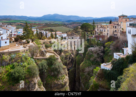 View from the 18thC Puente Nuevo spanning the El Tago Gorge above the River Guadalevin, Ronda, Andalucia, Spain - Stock Photo