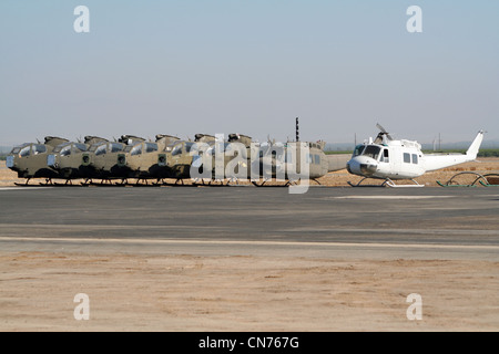 Stored US Army attack helicopters on an airfield in California - Stock Photo