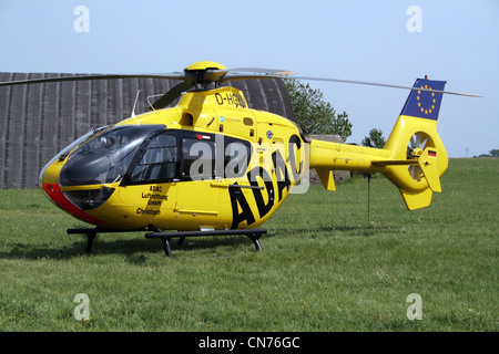 German ADAC (German automobile club) Eurocopter EC135  air ambulance helicopter - Stock Photo
