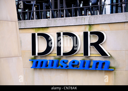 Berlin, Germany. DDR Museum sign on the Spree embankment - Stock Photo