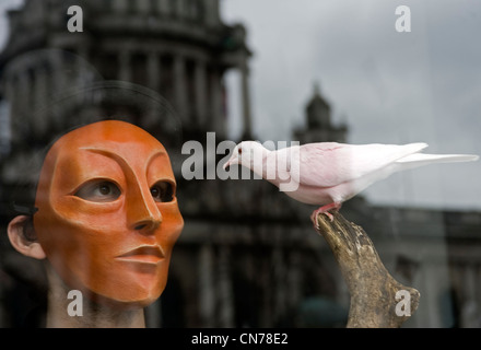 Masked man with colored dove, City Hall, Belfast. - Stock Photo