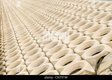 Pre-cast concrete revetement sea defences - Stock Photo
